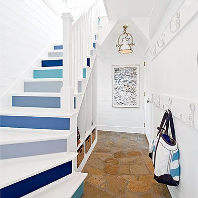 Paint risers a mix of shades in a single color to create visual interest as your eye follows the stairs. An otherwise neutral entry provides a backdrop for statement-making color.