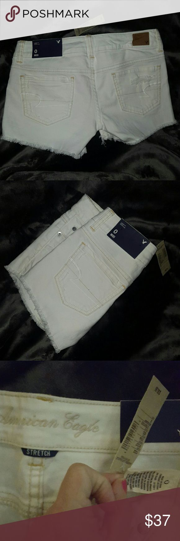 NEW MIDI DISTRESSED Jean Shorts American Eagle Size 0 ~ 98% cotton 2% spandex ~ New with Tags White frayed and distressed as purchased MIDI Jean shorts from American Eagle. Perfect for the upcoming season! I ship daily American Eagle Outfitters Shorts Jean Shorts