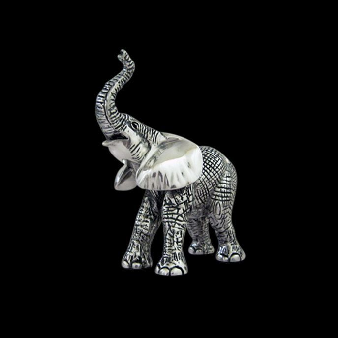 This Silver Baby Elephant Sculpture A55 By DArgenta Artist Benjamin Cortes Gently Raises Its