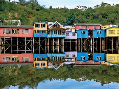 Colorful palafitos (stilt houses) on the island of Chiloe, the culture of which diverged from mainland Chile's centuries ago.