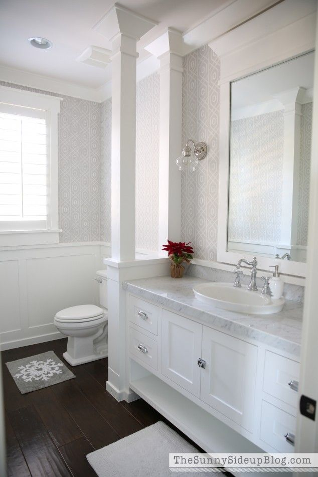 Powder bathroom. Love the columns to give some privacy, the semi sink and the wood -like tile.
