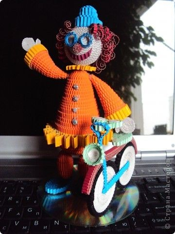 Quilled Clown with his Bicycle