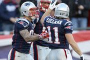 Rob Gronkowski #87 of the New England Patriots is congratulated by teammates Aaron Hernandez #81 and Julian Edelman #11 after Gronkowski scored a touchdown in the second half against the Indianapolis Colts on December 4, 2011 at Gillette Stadium in Foxboro, Massachusetts.
