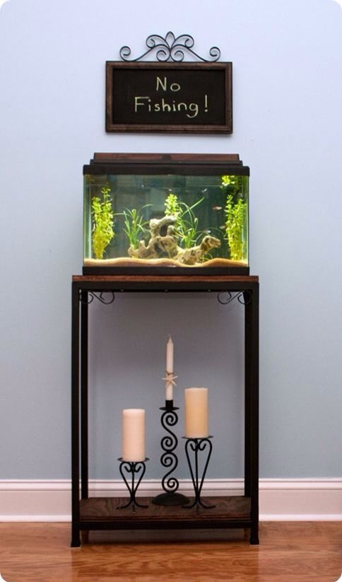 [not this decor but aquarium approx this size; eye level for children on low side table]