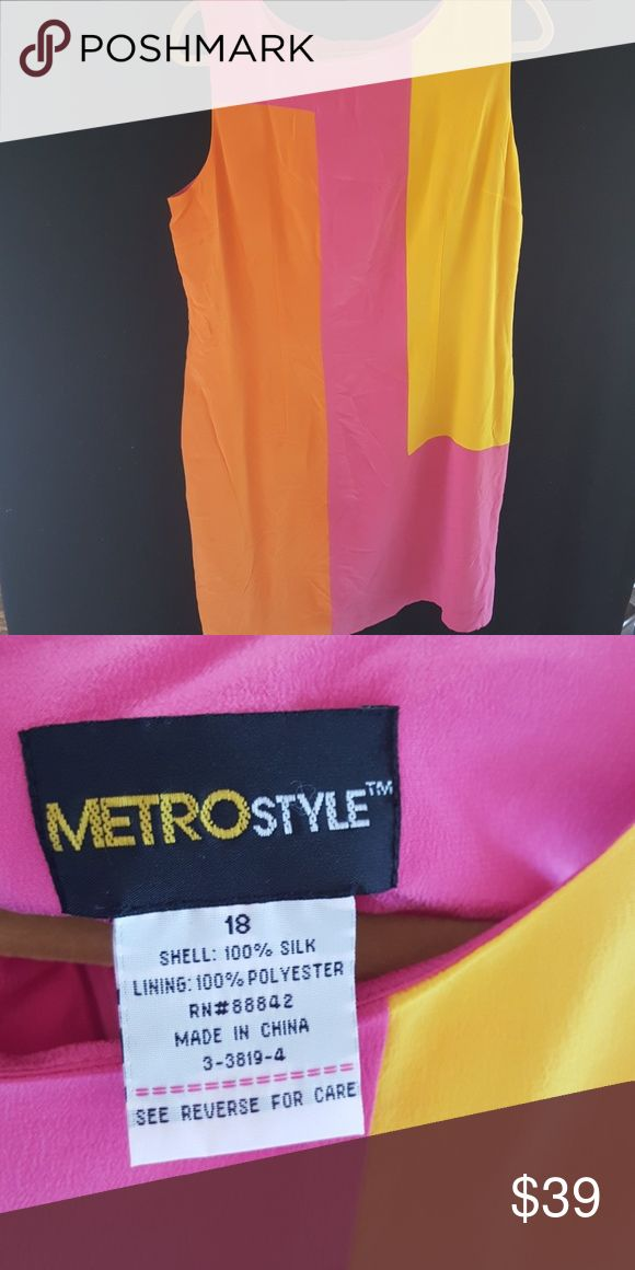 Beautiful silk dress Metrostyle Beautiful silk dress in pink yellow and orange size 18 Lining is 100% polyester, shell is 100% silk. I am 5'8 this galls just below the knee Metro Style Dresses
