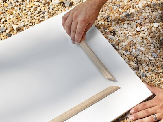 For updating our hollow core doors:  Add half-round decorative molding  Using a miter saw, cut decorative molding to size, then miter edges. Add wood glue to back of molding, pressing each piece in its place. Once glue has dried, caulk inside and outside edges of molding.