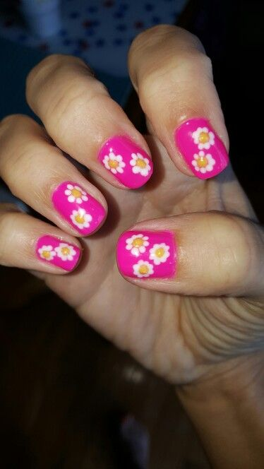 Right hand daisy nails done with gel polish and a dotting tool.