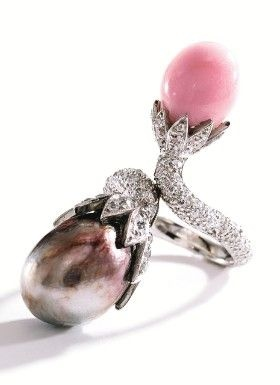 Platinum, Natural Pearl, Conch Pearl and Diamond Ring - Photo Sotheby's    Of crossover design, set with one baroque pearl of pinkish brown hue measuring approximately 11.1 by 10.2 mm and one conch pearl measuring approximately 8.8 by 7.2 mm, accented by numerous single-cut diamonds