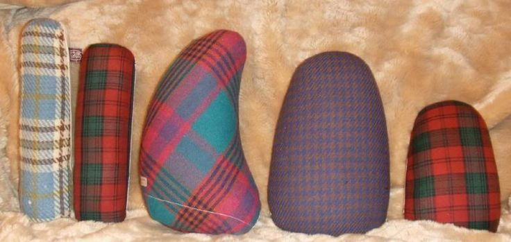 """Just this week I completed my pressing ham collection. Yes. Completed. I've had a seam roll and 6×9 Dritz pressing ham for about four years now. But, I never really knew there were more hams until a post by Els at the Sewing Divas. A few months later I picked up the Dritz Guide to Modern Sewing and read about the difference between a dressmaker's ham and a tailor's ham..."""