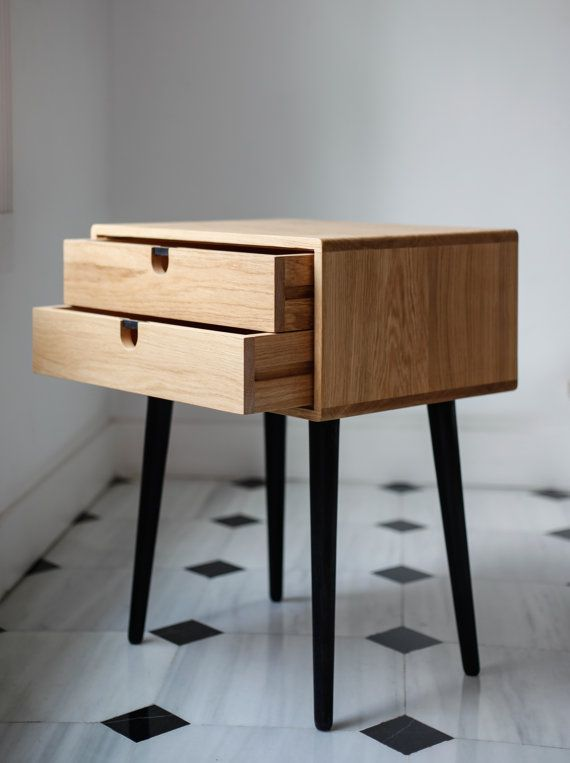 Our beautiful compact Mid-Century inspired Scandinavian Side Table / Nightstand features a frame made of solid oak , with two drawers and legs made of solid oak  Table 2 drawers  - 18.3 wide x 13.77 deep x 23.03 high (46,5 cm wide x 35 cm deep x 58.5 cm high) Table 1 drawer - 18.3 wide x 13.77 deep x 19.48 high (46,5 cm wide x 35 cm deep x 49.5 cm high) - Frame made from solid oak water-based lacquered or natural wax polished ,back made of plywood-  - Two wide drawers are crafted from solid…
