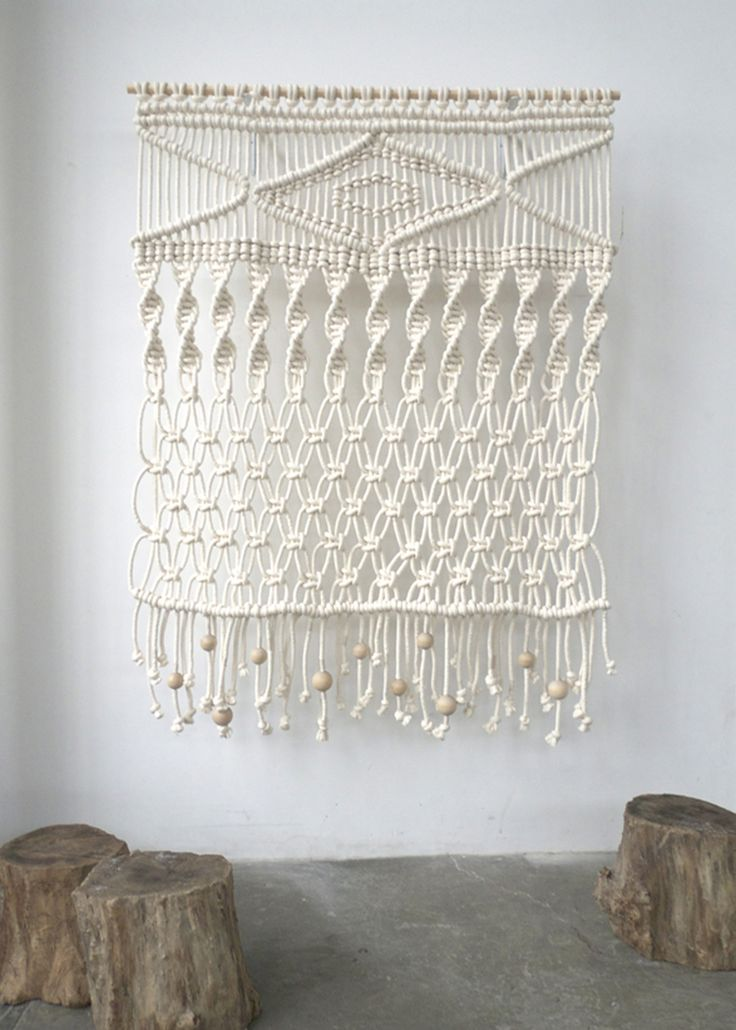 7' x 6'. Cotton cord, wood beads. 2011. Wall hanging and plant hangers created for the 1st year MFA exhibition at Pacific Northwest College of Art.