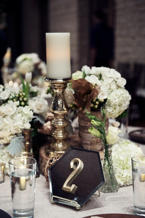white and green flowers, candles, and gold mercury glass centerpieces