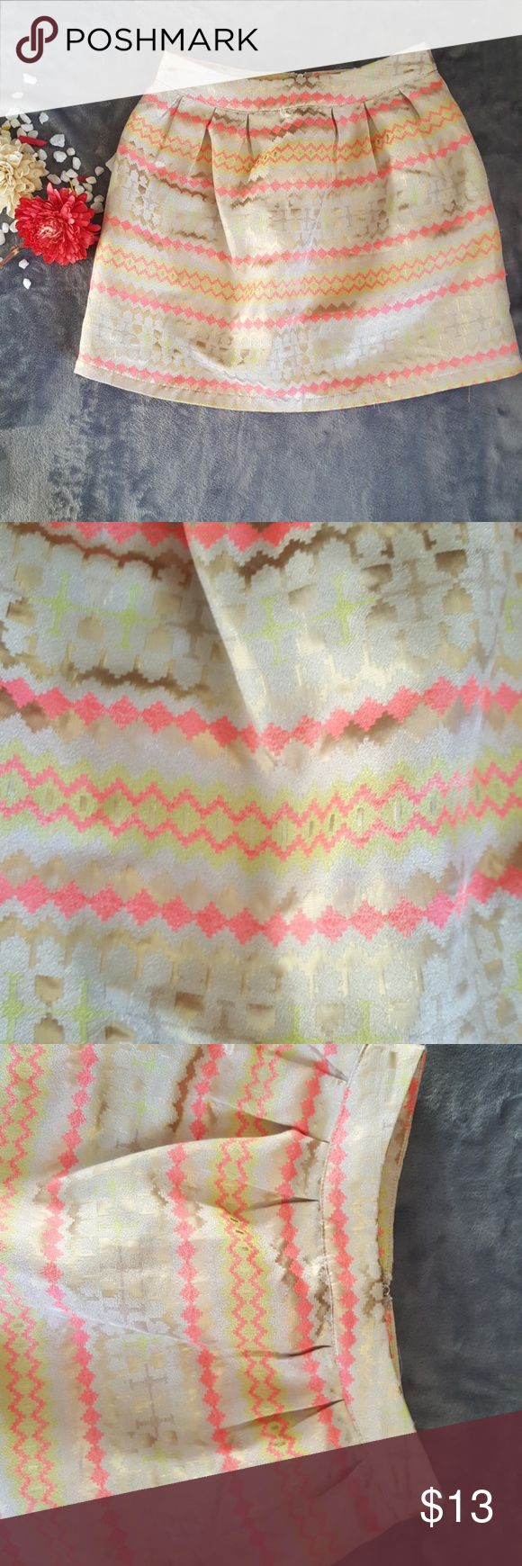 Tribal Print Skirt The color on this skirt is super vibrant and and stands out so much. There are no stains or loose strings and it has been washed and air dried already. It goes so amazing for summer and all the nice colors. jun&ivy Skirts A-Line or Full