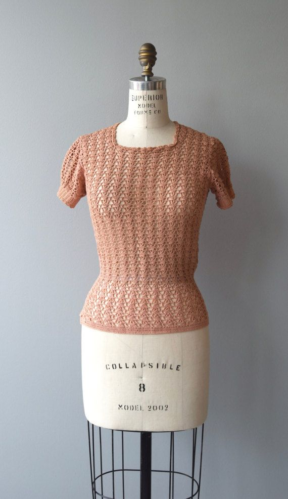 Vintage 1930s dusty coral cotton crochet sweater with short puff sleeves and mother of pearl side buttons.