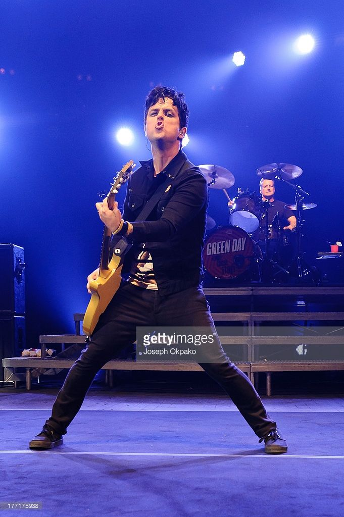 Billy Joe Armstrong of Green Day performs on stage at Brixton Academy on August 21, 2013 in London, England.