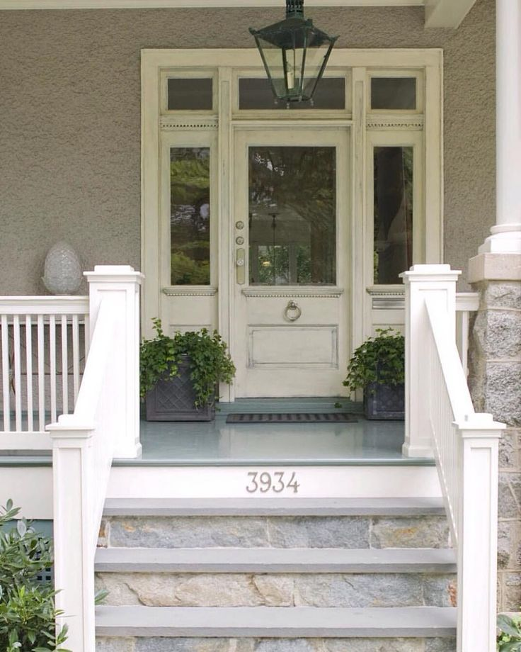 Flashback to our first old house renovation. The porch was a mess. Originally there were small (rotted) wooden steps. I replaced with stone risers and slate treads. And designed new railings to match the craftsman architecture. #houserenovation  #thisoldhouse