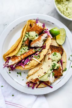 Blackened Fish Tacos with Creamy Avocado Sauce | http://foodiecrush.com