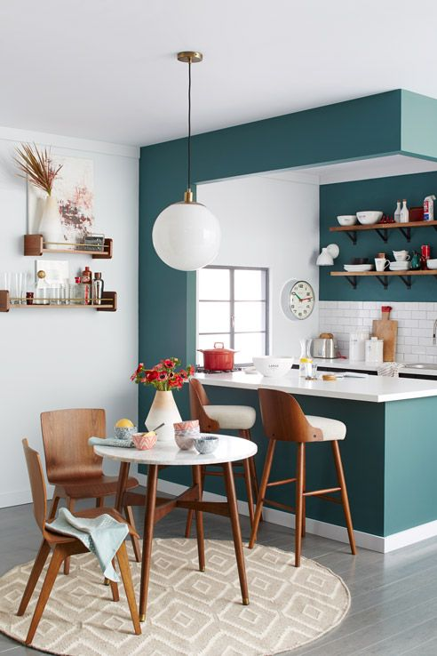 Love the blue paint color in the kitchen and white and wood accents of the furniture.