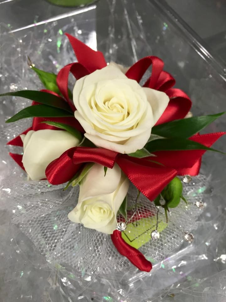 Wristlet Corsage With White Spray Roses Red Ribbon Clear