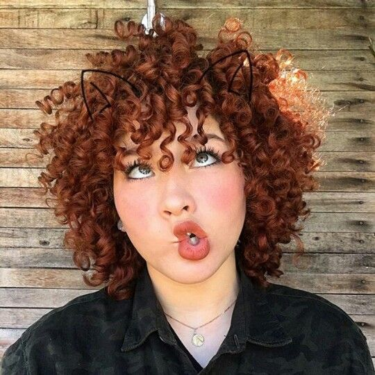 ~ My bubbe's hair was this colour.   Looks like an 'oy vey' moment.  Love her facial expression and great red curly hair. ~