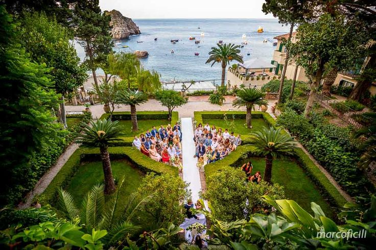 Stunning ceremony in the English Garden at Villa Sant'Andrea in Taormina. Civil wedding ceremony by the sea. Sicily wedding.
