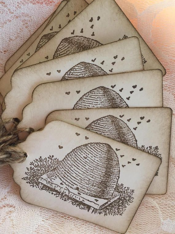 *Set of eight rustic style BEE Hive hang tags. *Hand stamped honey jar with brown ink on ivory card stock. *These tags measure approx 1 3/4 x 2 3/4 inches *The edges have been inked and each tag has been tied with a burlap string, completing the vintage style. *Come packaged in a