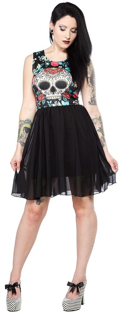 NEW BREED GIRL DAY OF THE DEAD CHIFFON DRESS Celebrate the Day of the Dead in this colorful sugar skull mini dress from New Breed Girl. Featuring a shiny stretch top, black mini skirt and black chiffon over skirt, this easy to wear style is so cute and comfortable! $36.0 #newbreedgirl #dress #sugarskull