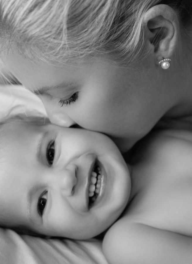 Black and White photo-Mommy kissing baby