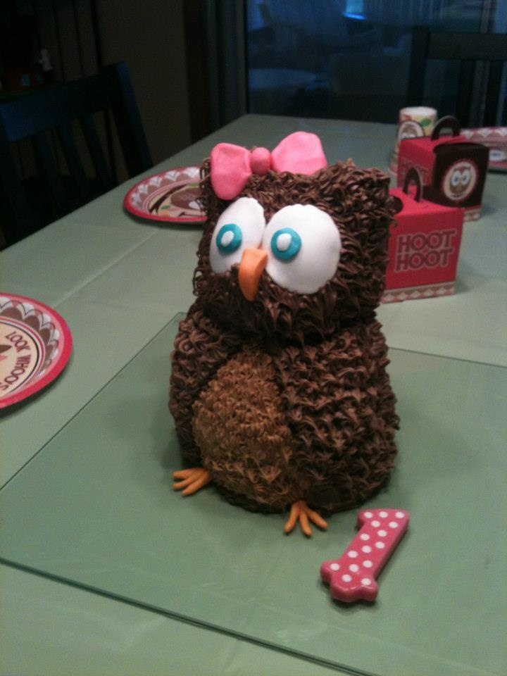 Owl Cake. Use the Wilton panda bear mold for this cake. Then shave off the arms. The eyes, beak, bow, and feet are marshmallow fondant. Double star your wings to make them stick out in a layered look. Be careful though not to make it too heavy. I did and a whole side of the owl fell right off and I had to redo it! This was a fun one to make because it looks super cool for the minimum amount of time and effort it takes to make! Use a lighter brown icing for the tummy.