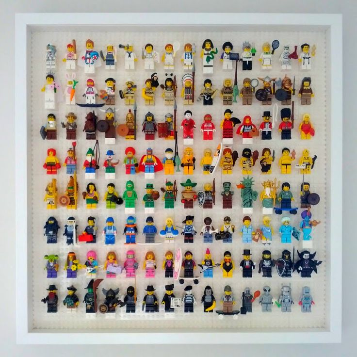 Lego minifigure display case: white 8x12 plates used in a Ikea Ribba frame, holds roughly 112 minifigures (rather than the 2x2 bricks in other pins).