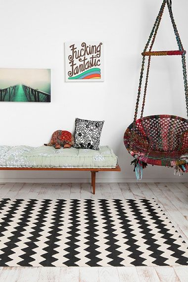 a cool boho-chic interior. love the hanging chair