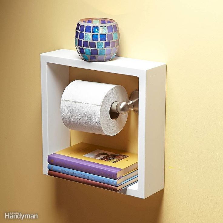 Here's a clever idea for a small bathroom shelf. Build or buy a deep picture frame and hang it around your toilet paper holder. It will give you two convenient shelves for small items in your bathroom where every inch of storage counts.