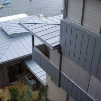 This castle crag residence in clad in Rheinzink Titanium zinc using the double standing seam system...
