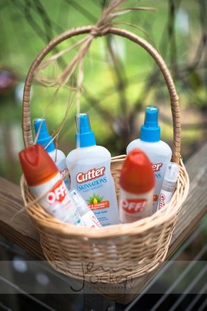 Bug spray in decorative basket for guests