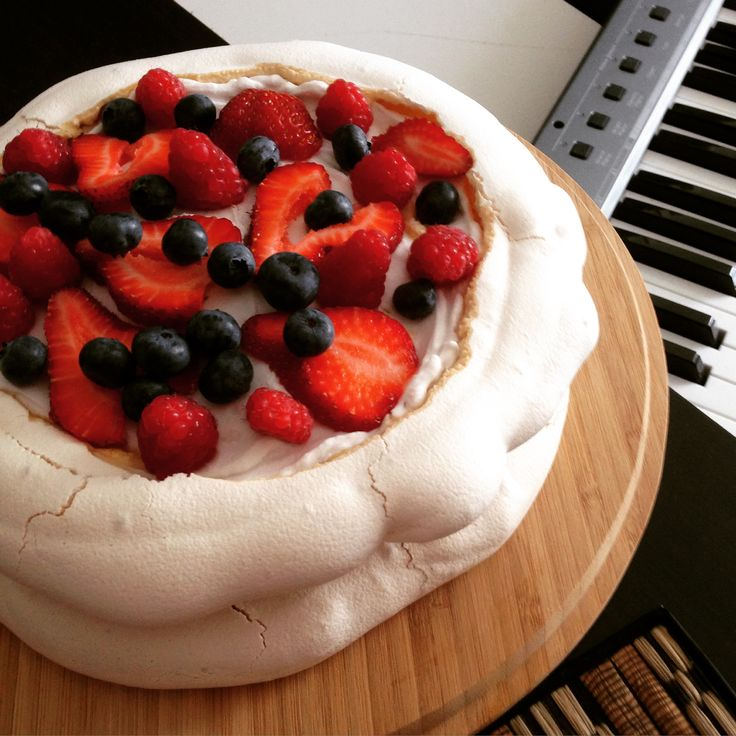 Vegan Pavlova  Double decker aquafaba pavlova topped with whipped coconut cream and fresh berries. All vegan. Magnificent