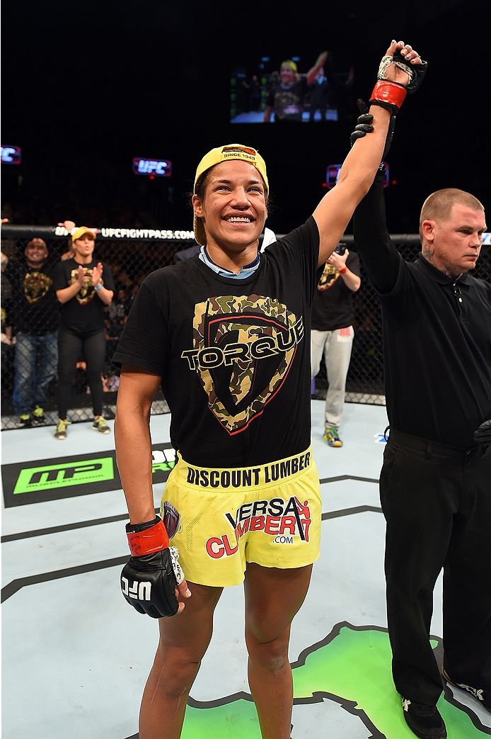 FAIRFAX, VA - APRIL 04:  Juliana Pena celebrates after defeating Milana Dudieva in their women's bantamweight fight during the UFC Fight Night event at the Patriot Center on April 4, 2015 in Fairfax, Virginia. (Photo by Josh Hedges/Zuffa LLC/Zuffa LLC via Getty Images)