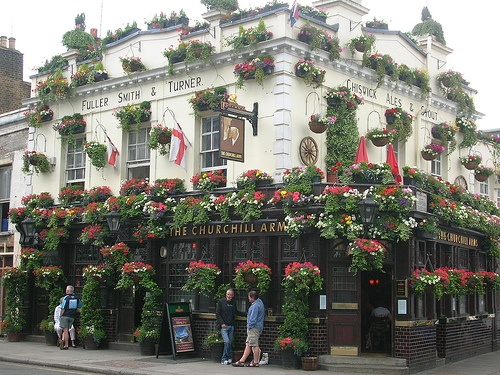 "Fullers Pubs, Restaurants and Taverns: Shown here is their Churchill Arms Pub & Tavern in the Kensington area of London England.  A beautiful and great example of ""Business Curb appeal"" at it's finest and what we call a ""ParadeOfGardens""!"