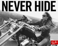 Biker babes in cool shades.  Hard to hide with those exhaust pipes blaring...