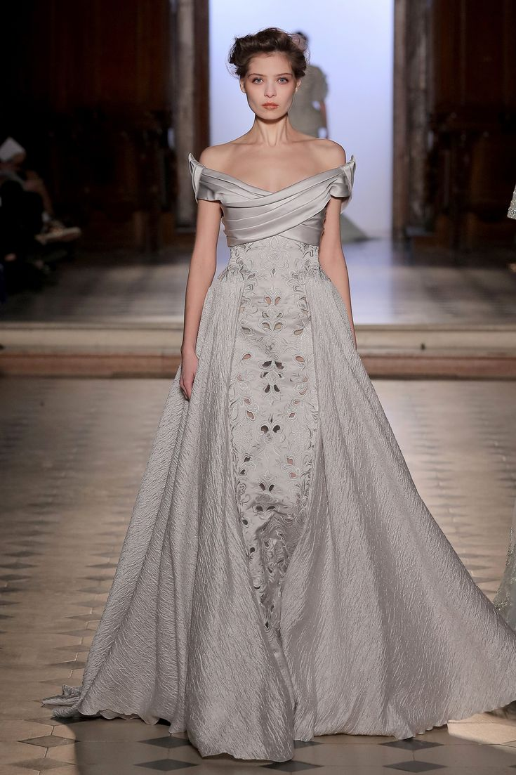 Tony Ward Couture richy embellished evening gown in soft grey. Enjoy RUSHWORLD boards, UNPREDICTABLE WOMEN HAUTE COUTURE, WEDDING GOWN HOUND and LULU'S FUNHOUSE. Follow RUSHWORLD! We're on the hunt for everything you'll love! #HauteCouture #WhatToWear #UnpredictableWomenHauteCouture
