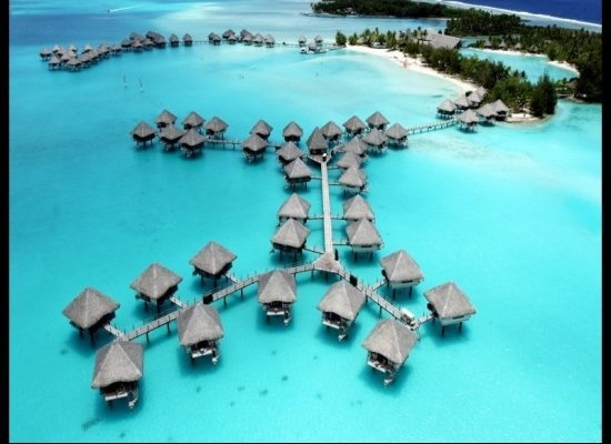 12 Hotels With Overwater Bungalows (PHOTOS) - pictured here is Le Meridien Bora Bora