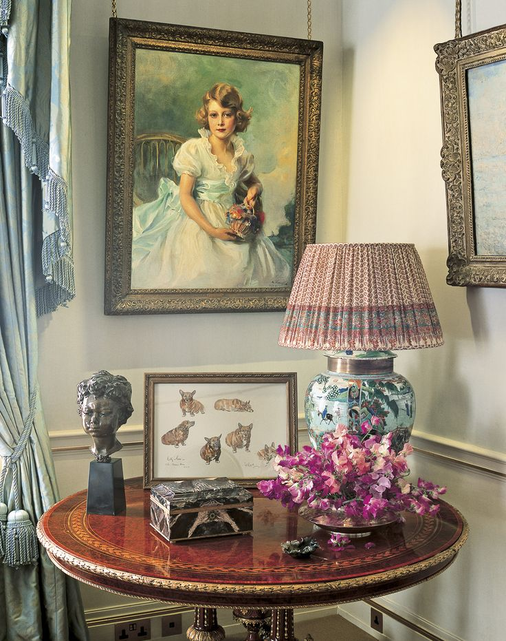 The Morning Room. Clarence House. Home of Charles and Camilla. In the corner is a painting of the Queen Elizabeth as a little girl. And notice the framed drawing of the Queen Mum's corgi dogs. Beautiful lamp.