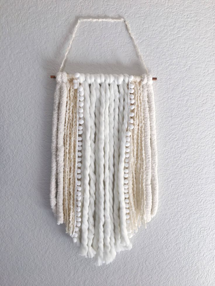 Yarn wall hanging by TheLittleWiseFoundry on Etsy https://www.etsy.com/listing/555869641/yarn-wall-hanging