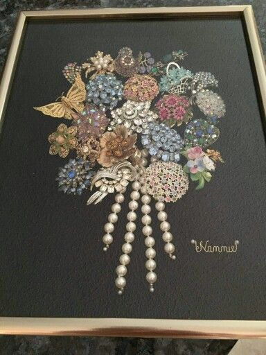 Pin/brooch bouquet. Something to do with all those old pins
