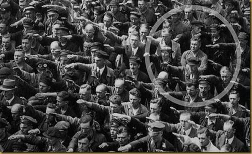 servile-masses-arise:  demons:   Ordinary people. The courage to say no.  The photo was taken in Hamburg in 1936, during the celebrations for the launch of a ship. In the crowd, one person refuses to raise his arm to give the Nazi salute. The man was August Landmesser. He had already been in trouble with the authorities, having been sentenced to two years hard labor for marrying a Jewish woman. We know little else about August Landmesser, except that he had two children. By pure chance, one…
