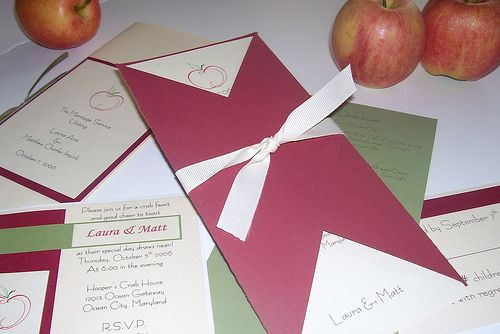 An Apple a Day~A great fall wedding invitation. What is everyone's favorite fall fruit? Apples of course!!!! This tuxedo style invitation gives your guest a little peek on what's inside. The invite and information card slide right into the maroon sleeve. Also pictured is a matching program and rehearsal dinner invites.