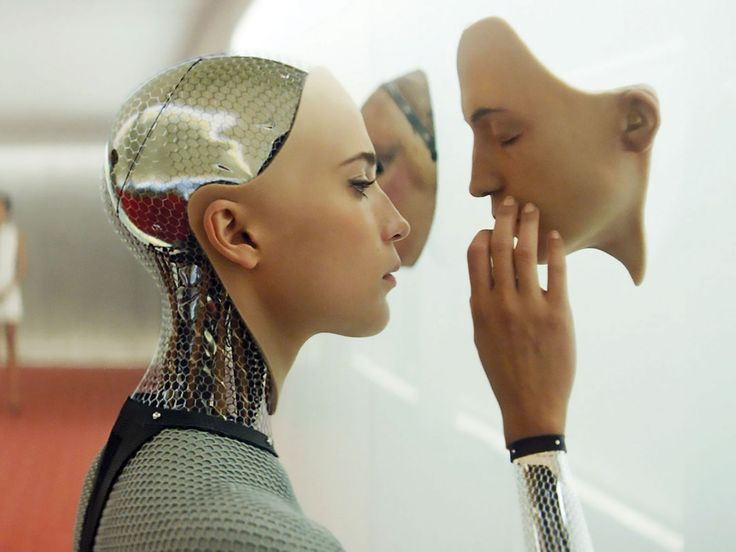 """Ava from Ex-Machina (2015) played by the beautiful Alicia Vikander. In my opinion, she was the perfect casting voice: beautiful face, sultry voice… Too shallow? I think not. What if Ava looked like a plain Jane? Would Caleb still develop feelings for her? Oh yeah, the poor man was smitten.  Caleb became the ultimate cliché when he fell for """"the damsel in distress""""."""