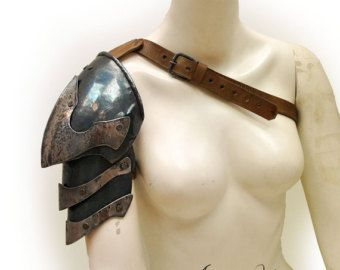 Norse fantasy steel and leather shoulder armor with scalemails. female Size. viking armor. Barbarian Style. Tribal armor. Larp Party Costume. THE ARMOR CAN BE WORN OVER AN ORDINARY SHIRT WITH NO PROBLEM.  Fabricated in steel 1.2 mm / 18 ga , and 3.5 mm / 1/8 thick leather. The hair is synthetic. buckles forged steel .  The armor can vary in size depending on the size requirements of each customer. They will not necessarily be the size shown in the photograph.  Mobility video of the shoulder…