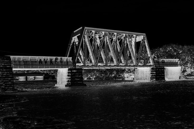 Canadian National Railway bridge over the Moira River at Belleville Ontario. HDR sequence shot. LIGHT, inverted and desaturated.