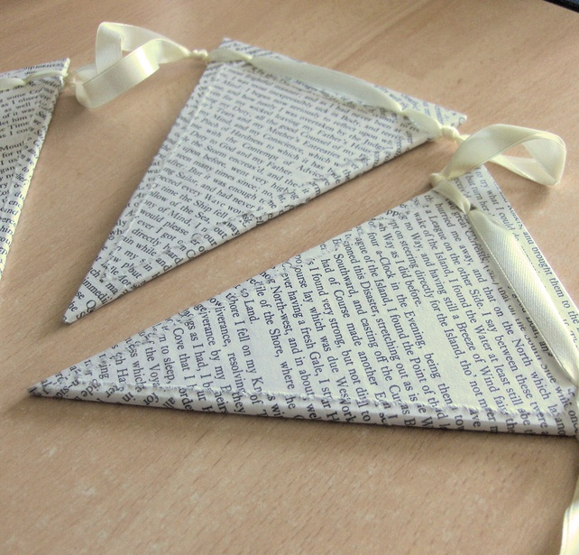 Cute bunting made from MDF covered with old book pages. (Edges of pages were torn for that whimsical look.)