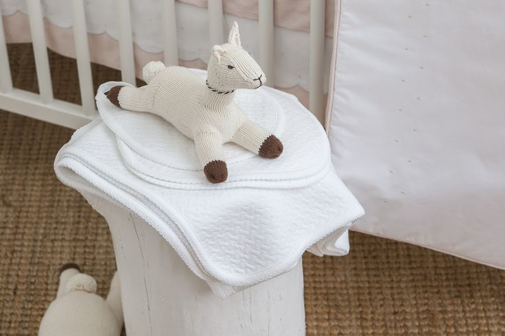 Our classic gift set contains a beautifully soft knitted bib, burp cloth and swaddle blanket in a timeless white design.